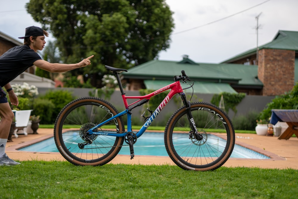 red and blue full-suspension mountain bicycle