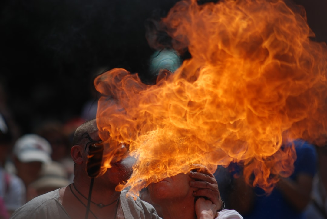 Flame-spitter lighting a woman's cigarette with fire