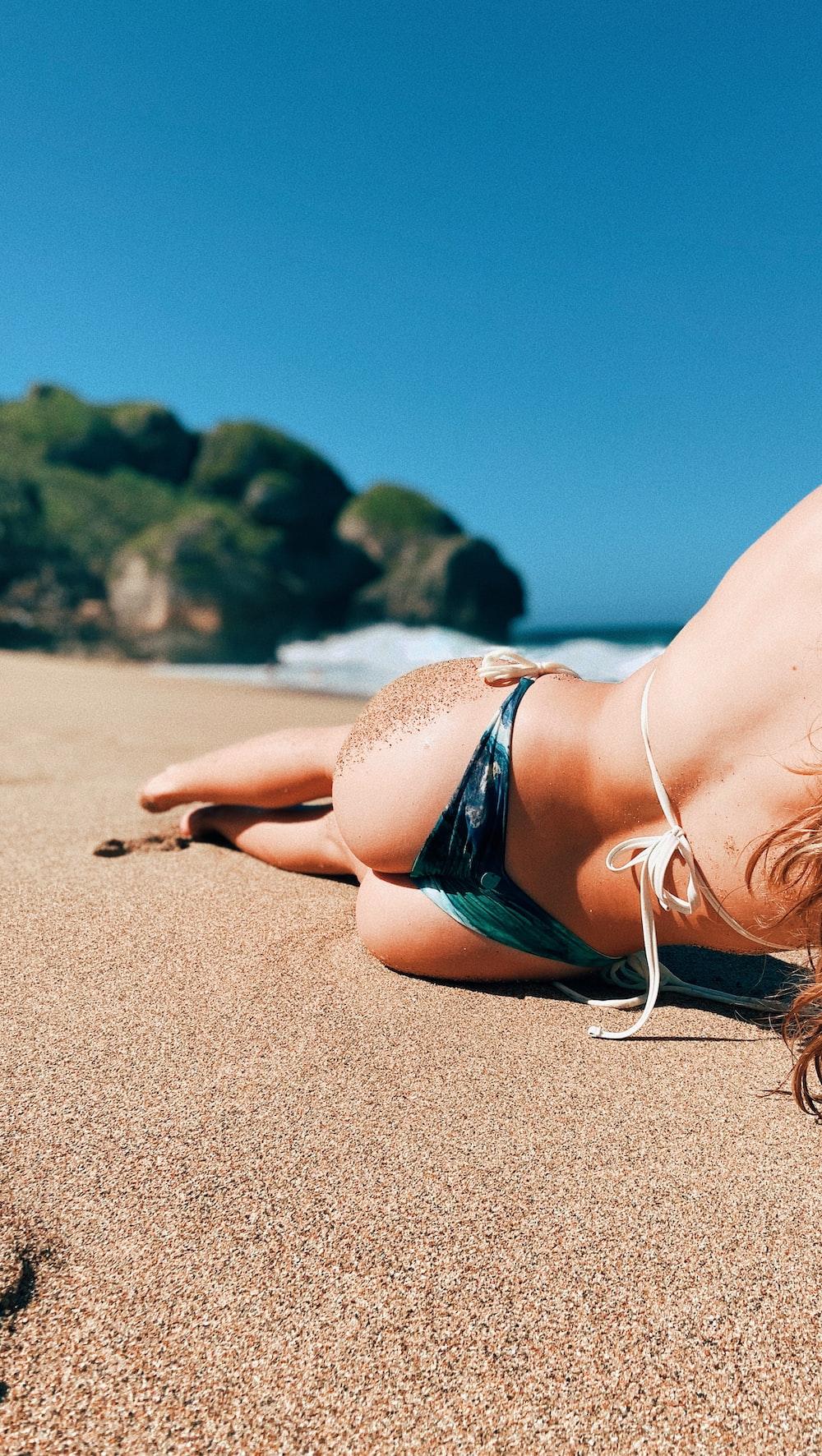 woman lying on white beach