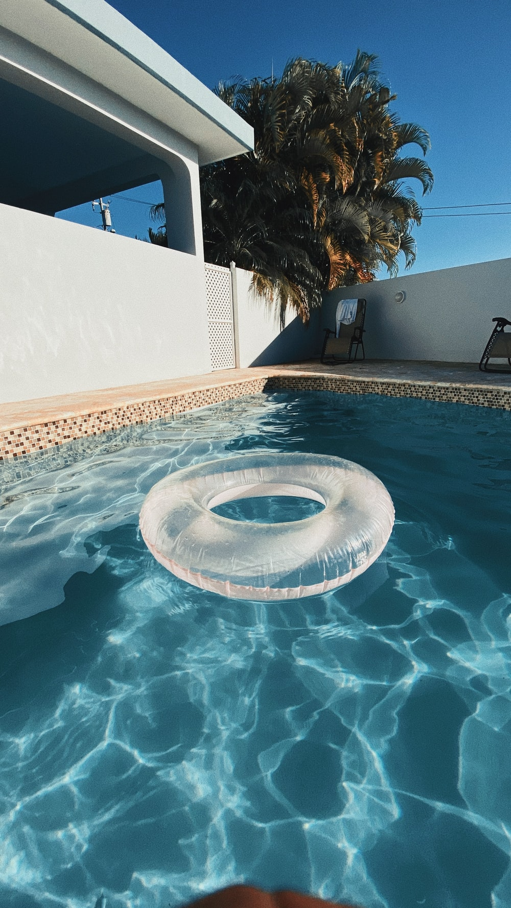 white life donut on swimming pool