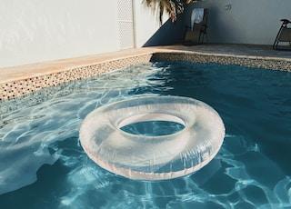 white life donut on swimming pool
