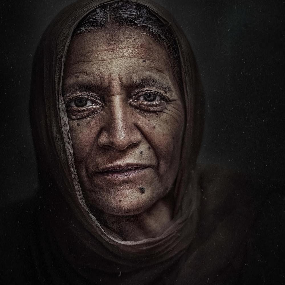 woman wearing hijab painting