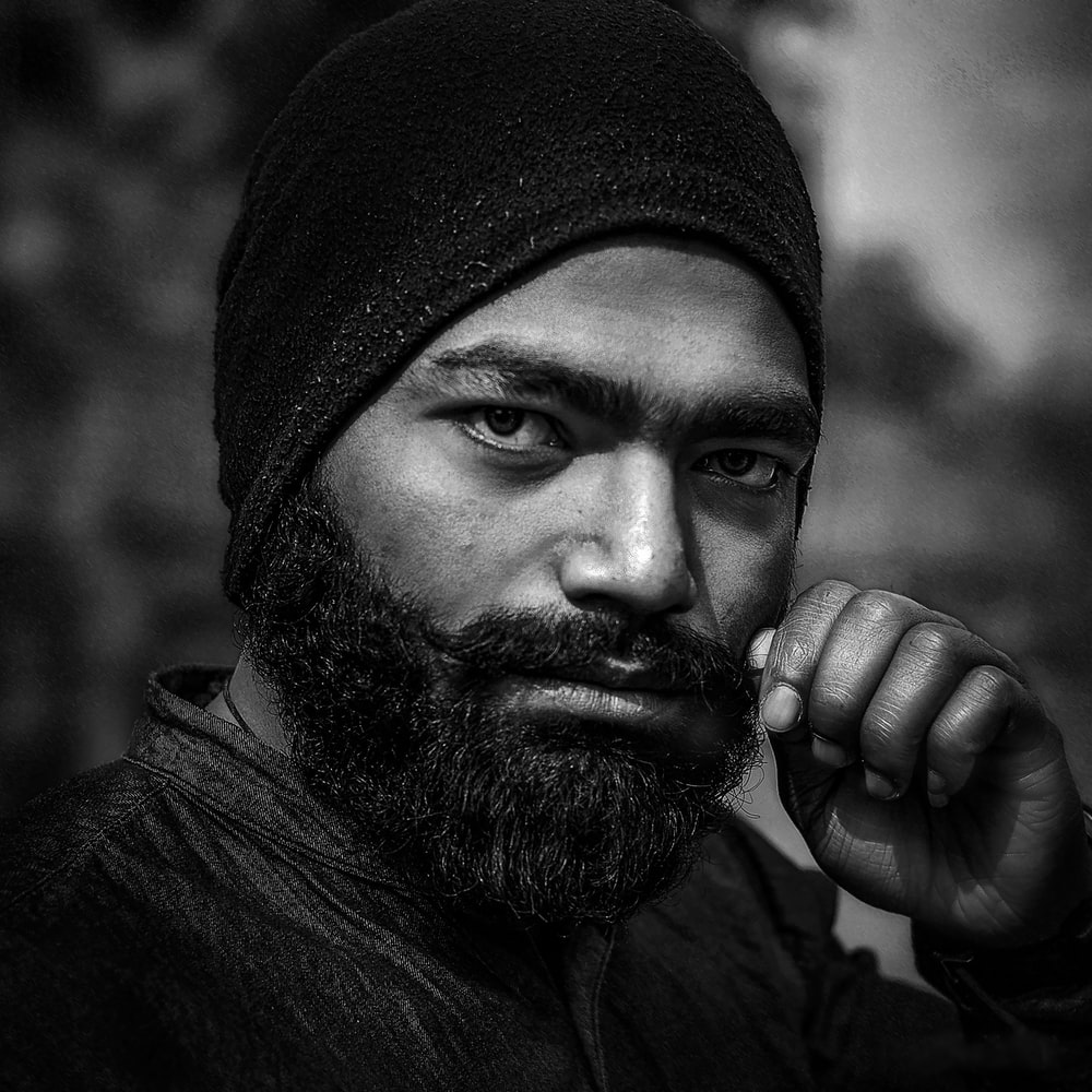 greyscale photography of man