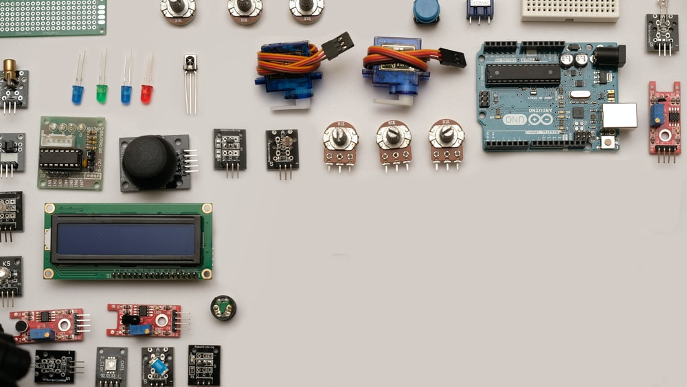 assorted-color capacitors on white surface