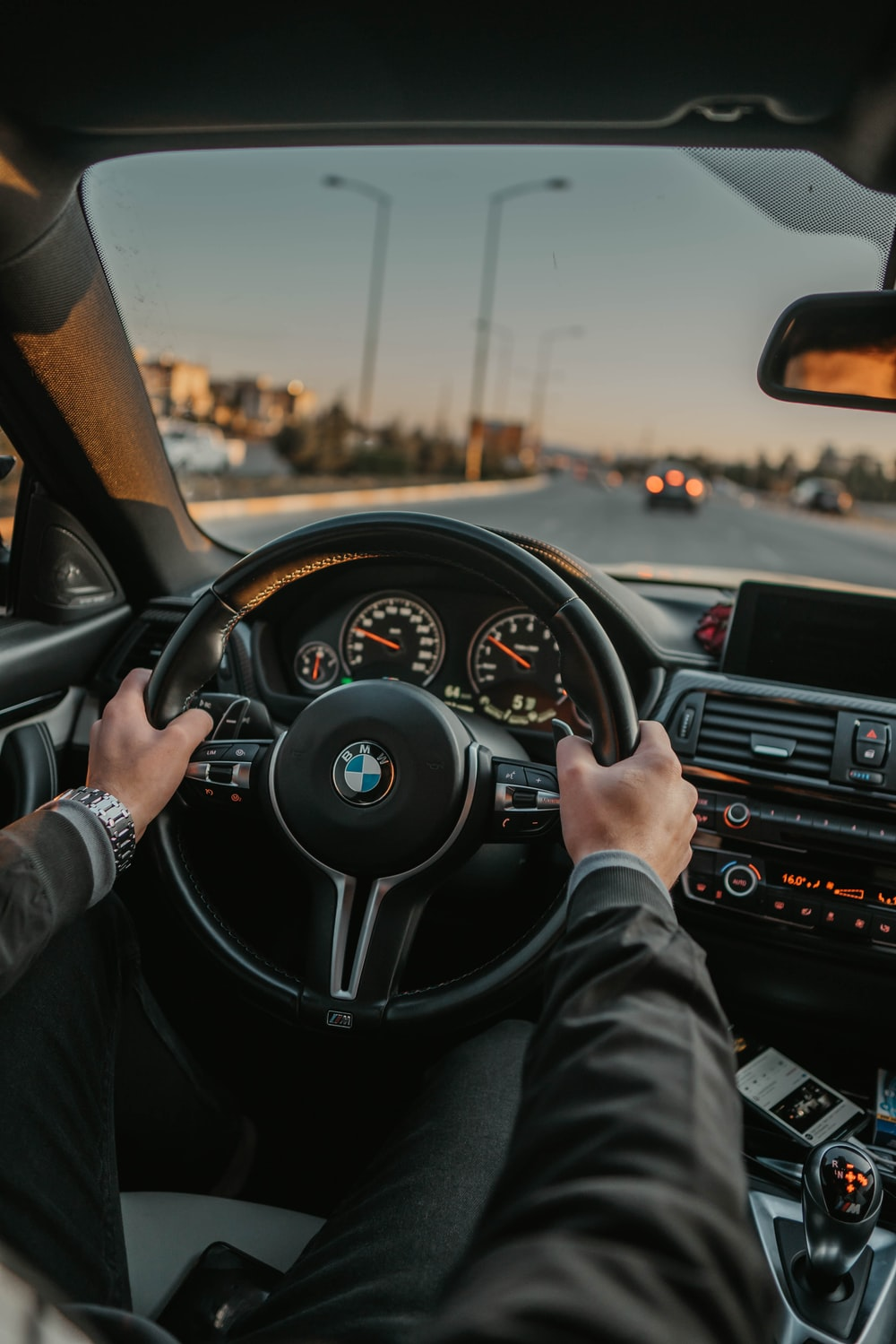 unknown person driving BMW car