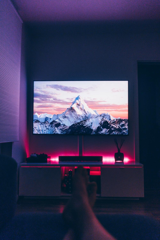 turned on flat screen TV inside room