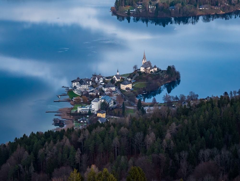 town in the middle of a lake surrounded by trees