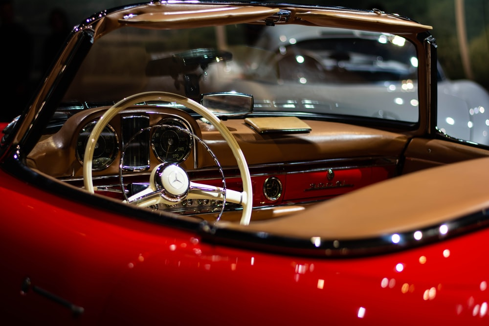 vintage red and brown convertible car