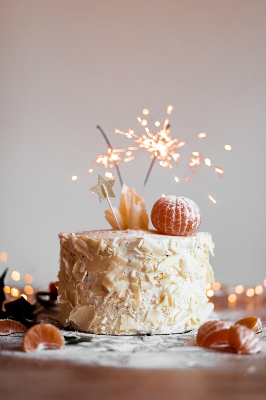 cake with lit sparkling stick
