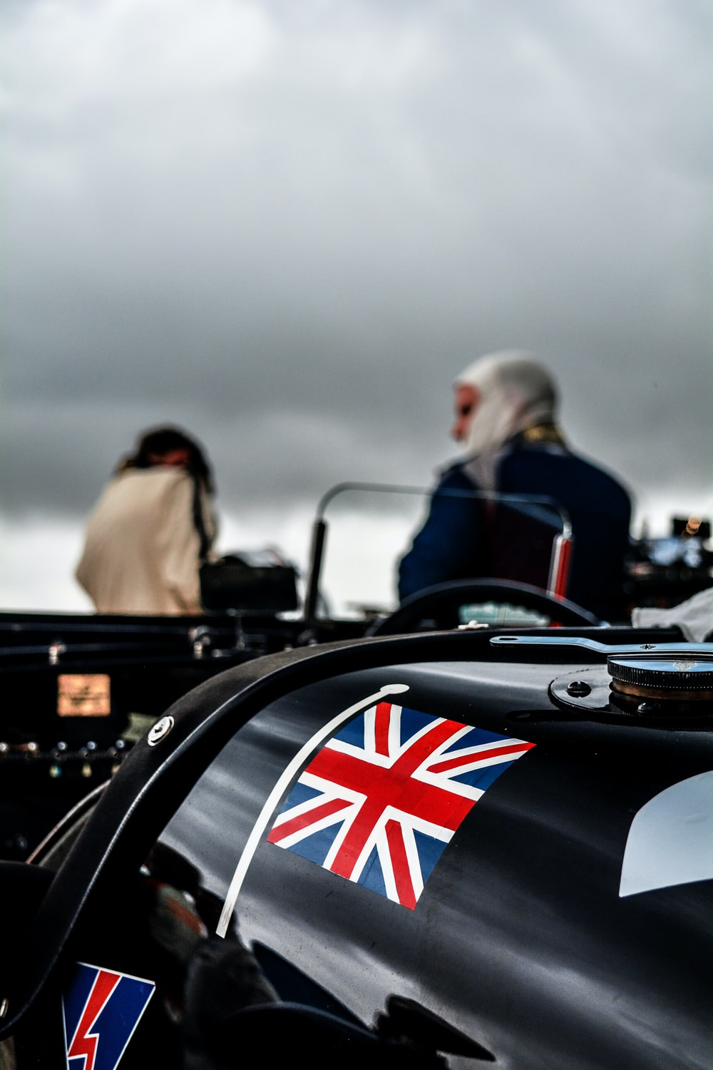 selective focus photography of UK flag on car