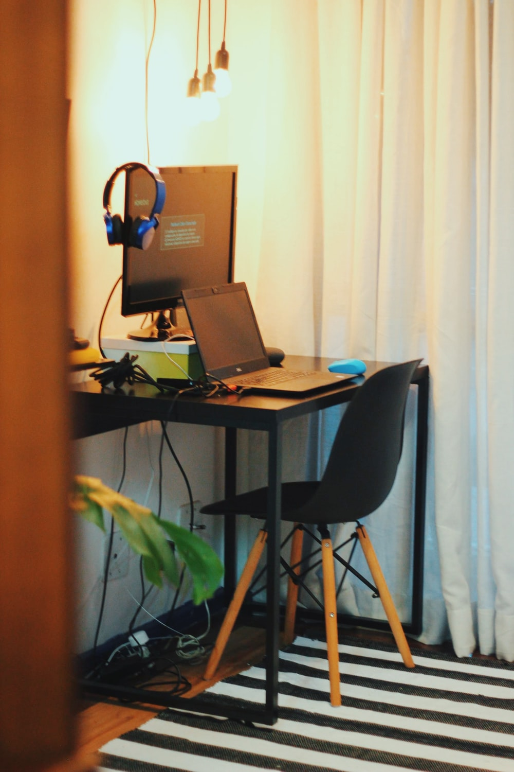 black wooden office table with laptop and monitor