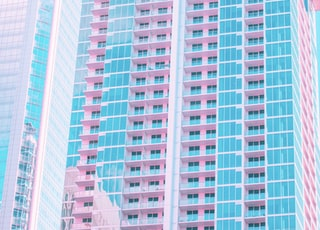 blue, pink, and white high rise building