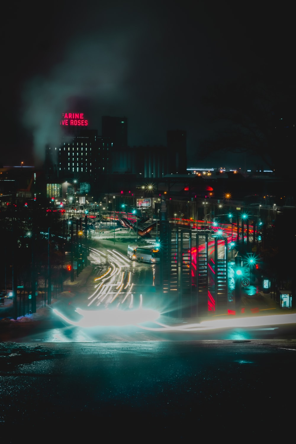 timelapsed photography of vehicles and buildings