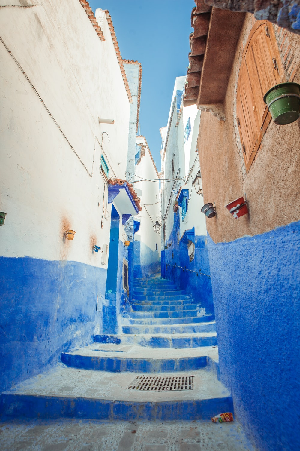 blue and white concrete hallway stairs