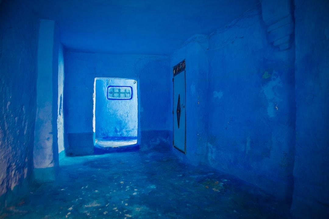 Empty Blue Concrete Room - unsplash