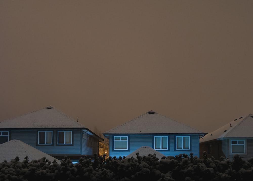 three blue houses