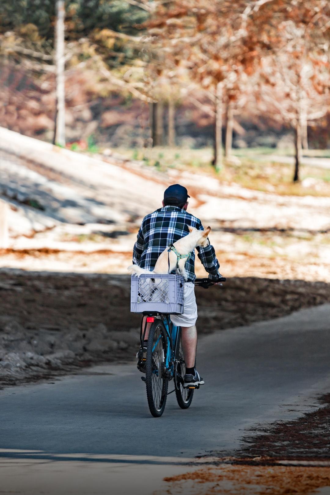 Man riding bike with dog in basket, Buffalo Bayou Houston, TX