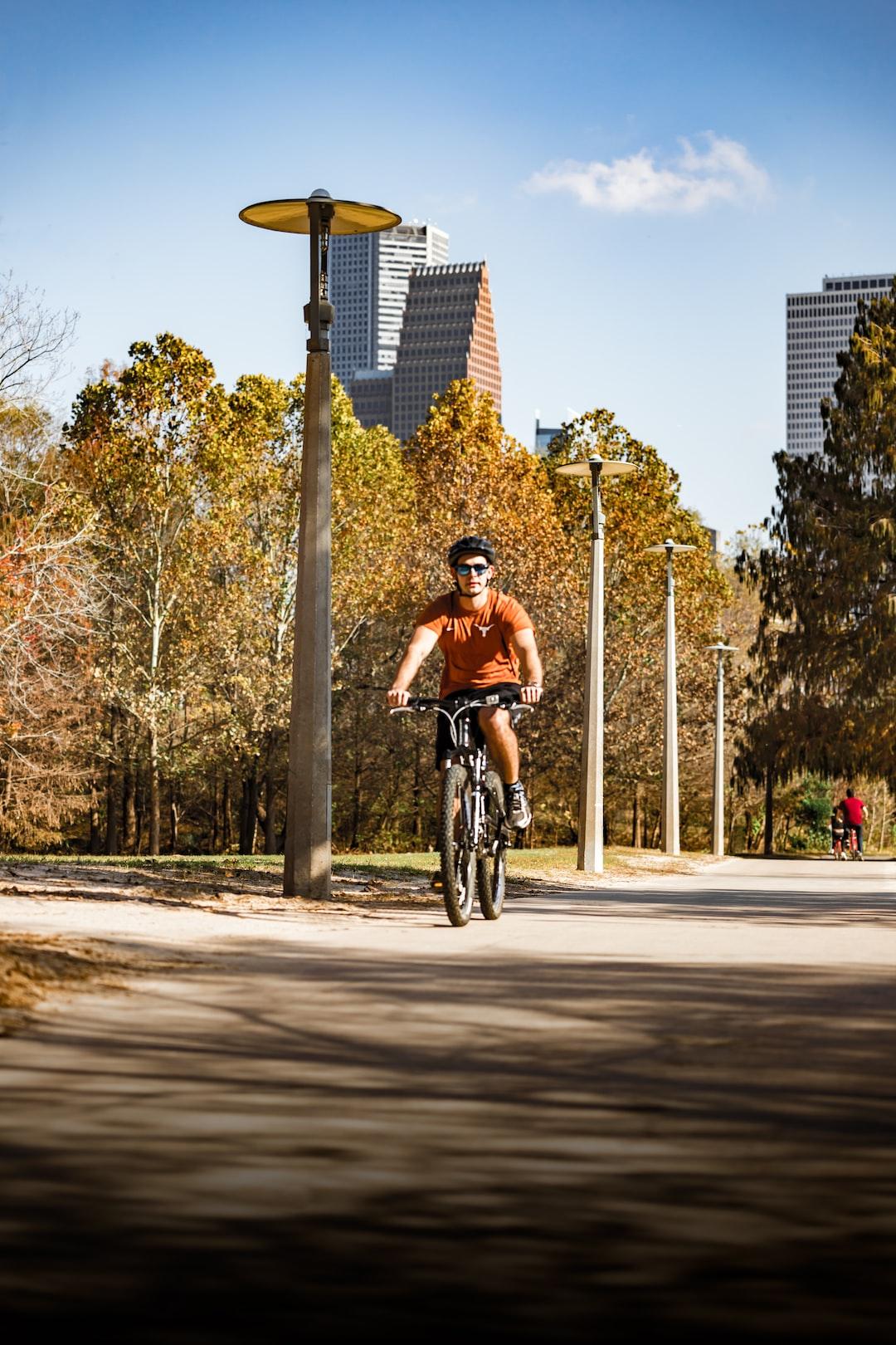 Bike rider along Buffalo Bayou Park, Houston TX