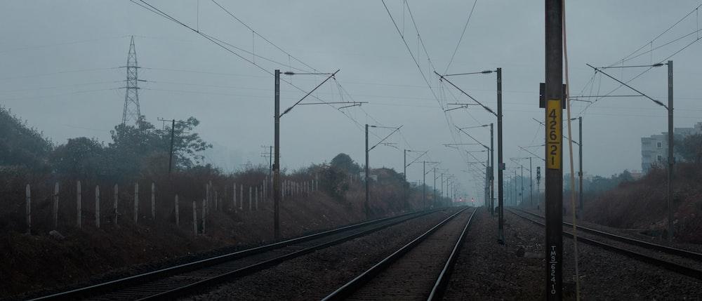 brown train railway in foggy day