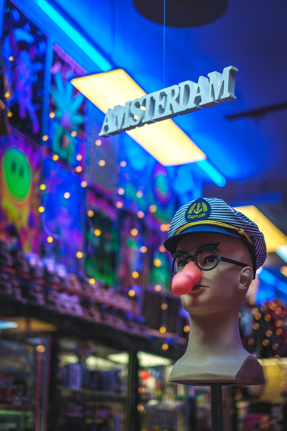 shallow focus photo of mannequin head wearing blue hat