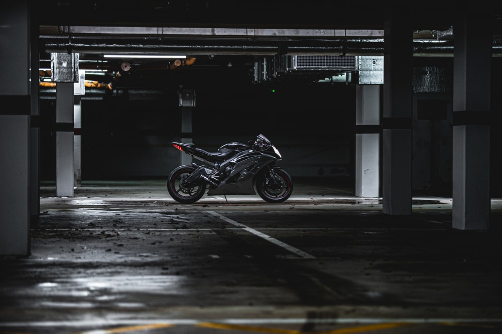 black sports bike parking in garage area