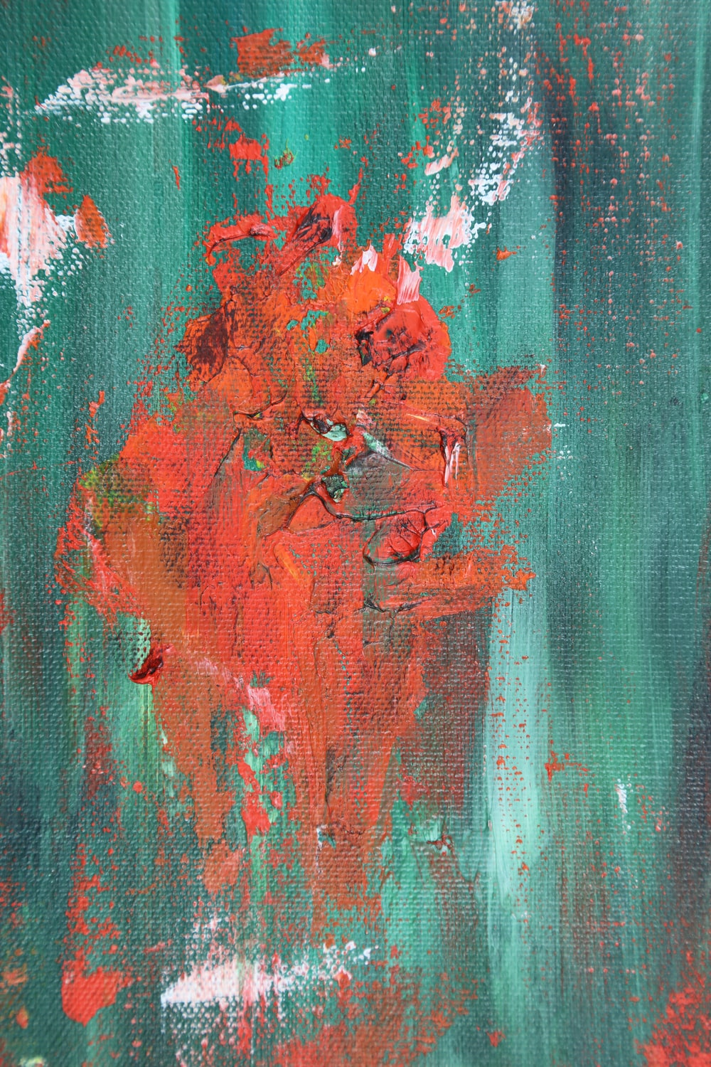 orange, white, and teal abstract painting