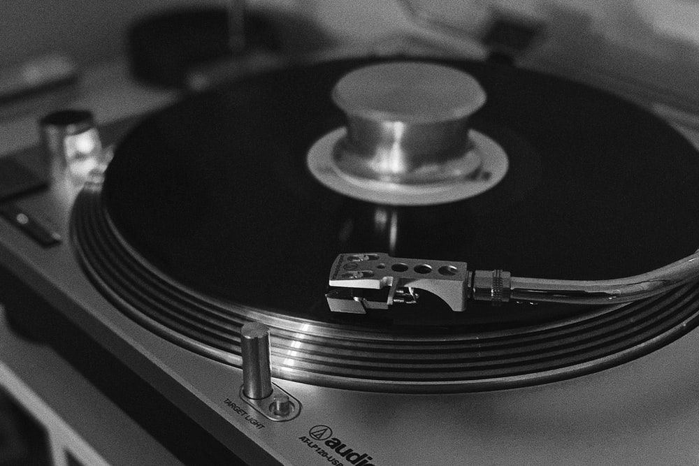 grayscale photography of a turntable