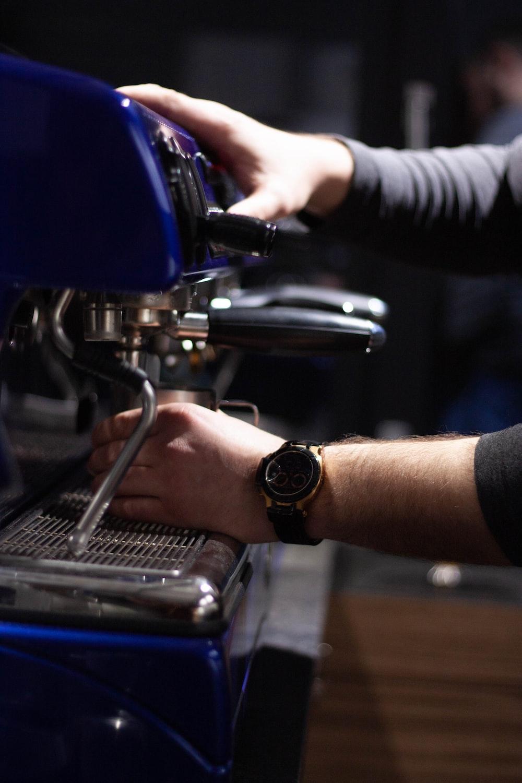 man using espresso machine