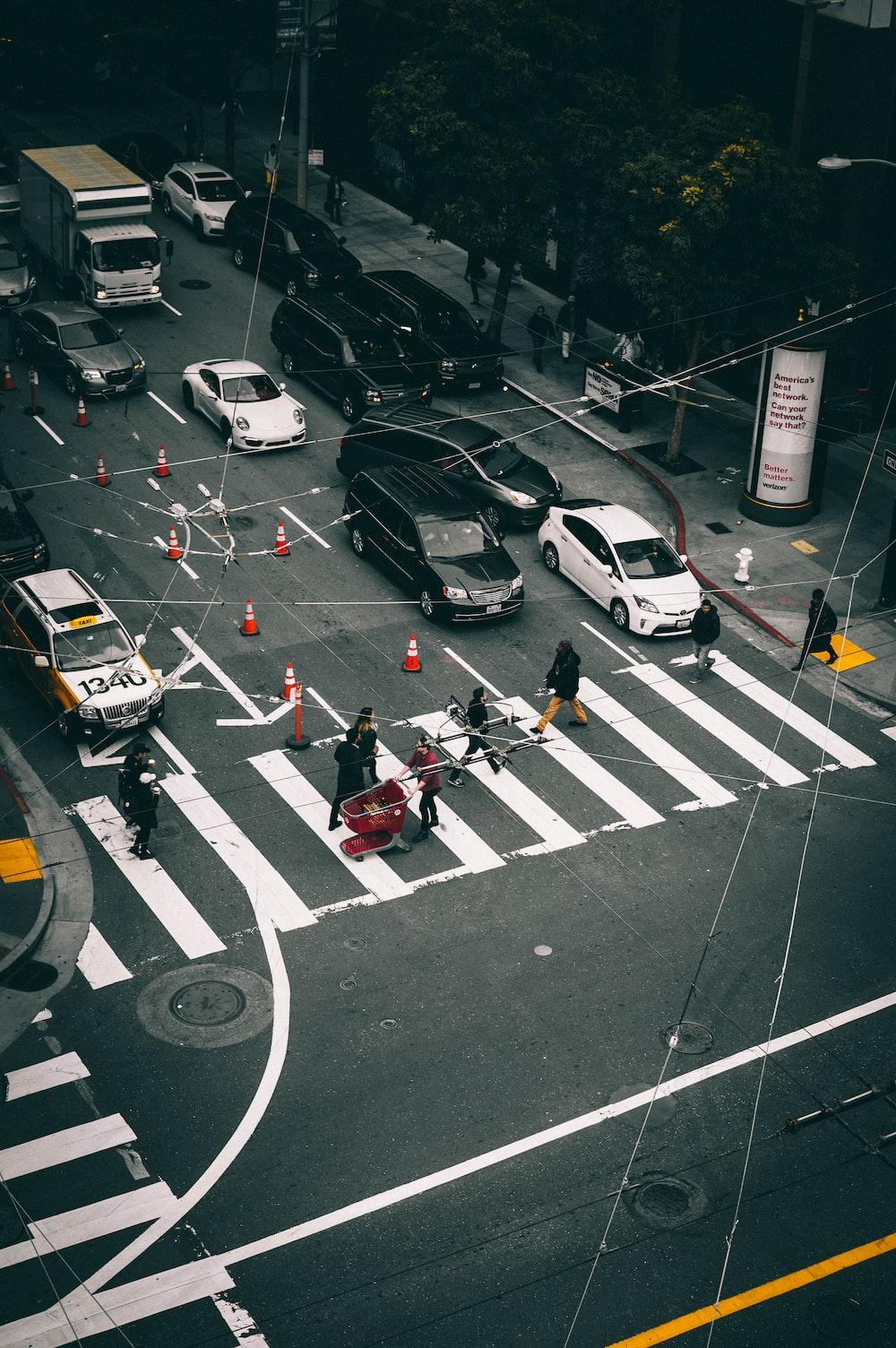 people crossing on pedestrian lane
