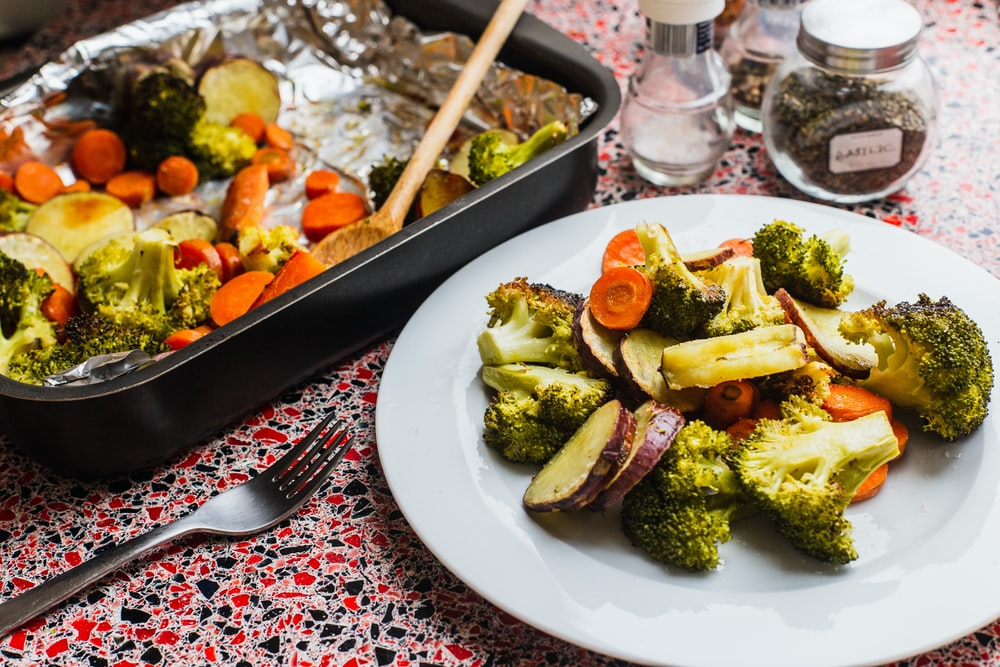 broccoli and carrots on white plate