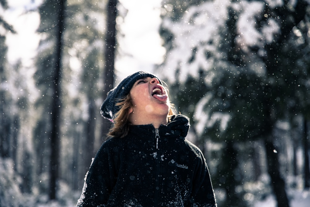 time-lapse photography of snow pouring on man's mouth