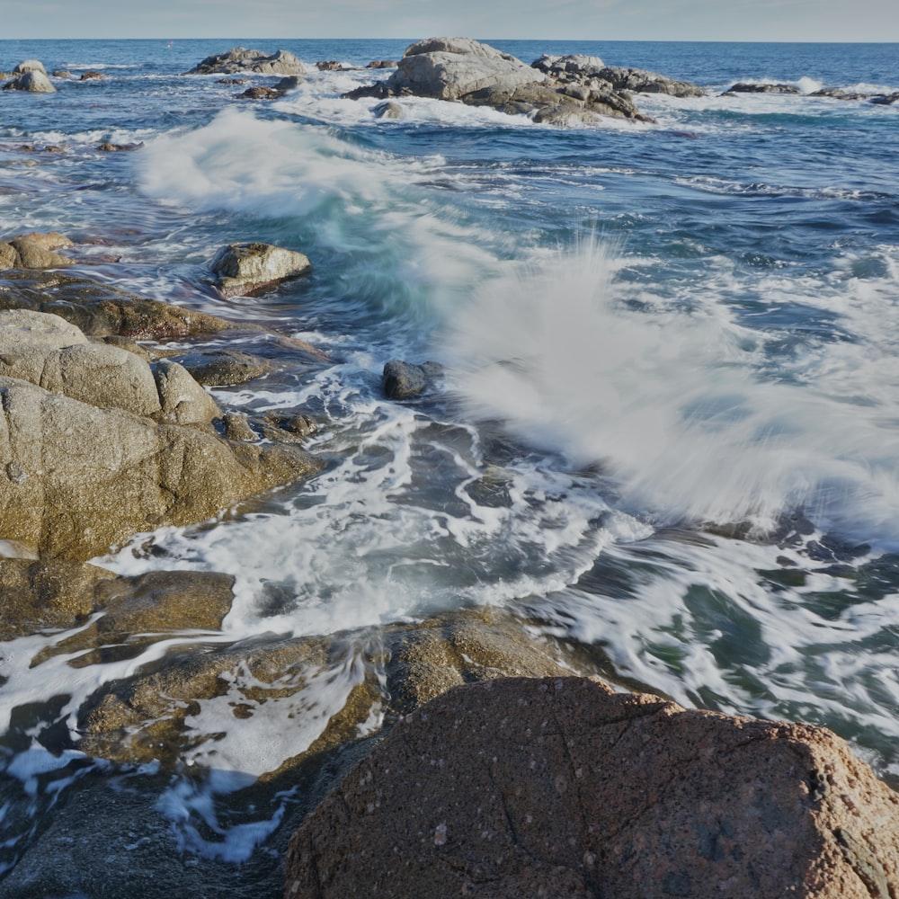 seawaves smashing on rocks