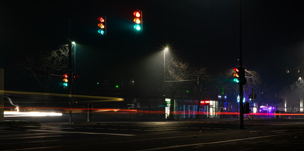 landscape time-lapse photography of cars passing by a street during nighttime