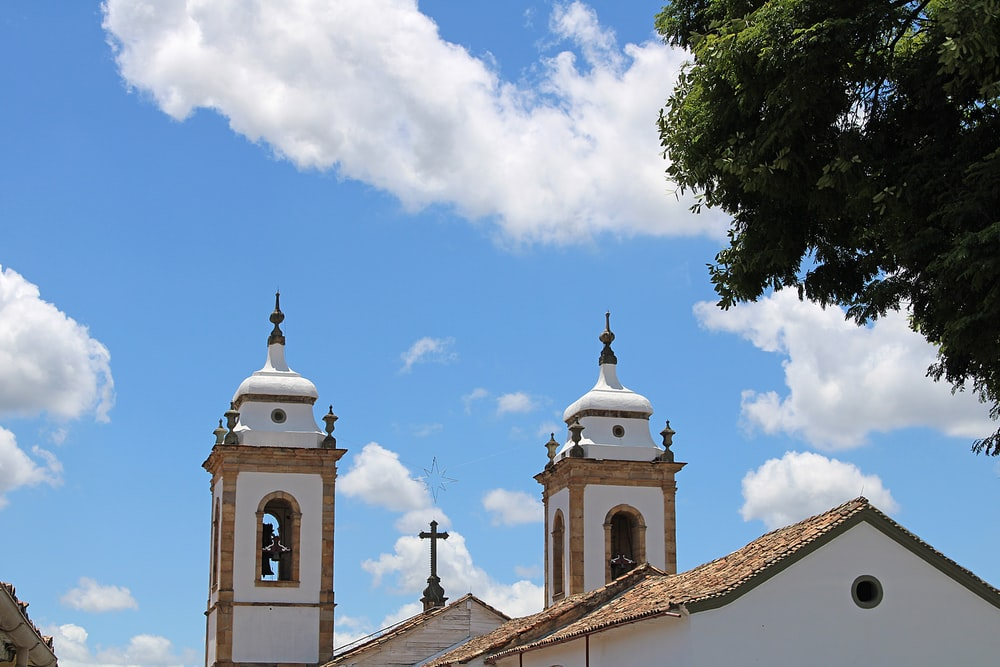 low-angle photography of white and brown church