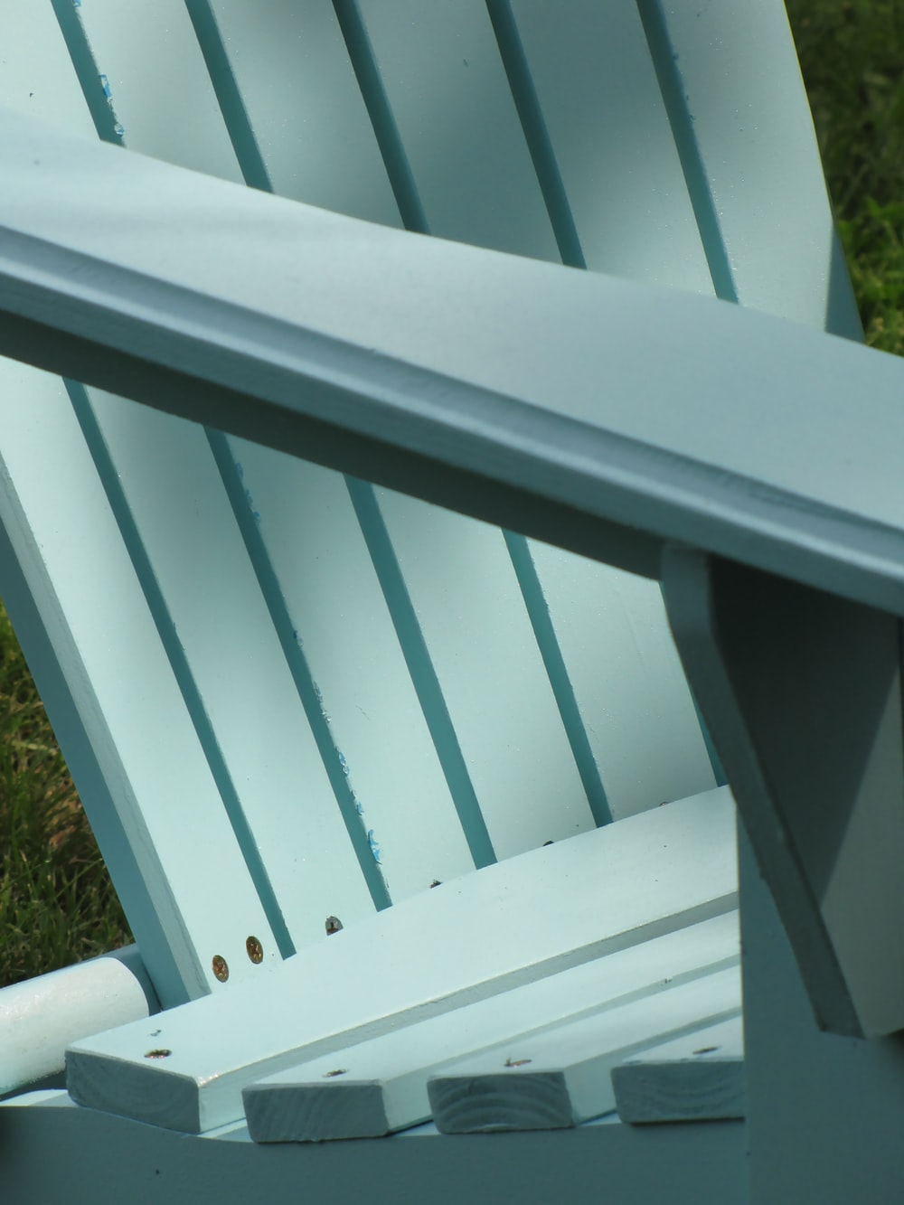 gray wooden adirondack chair