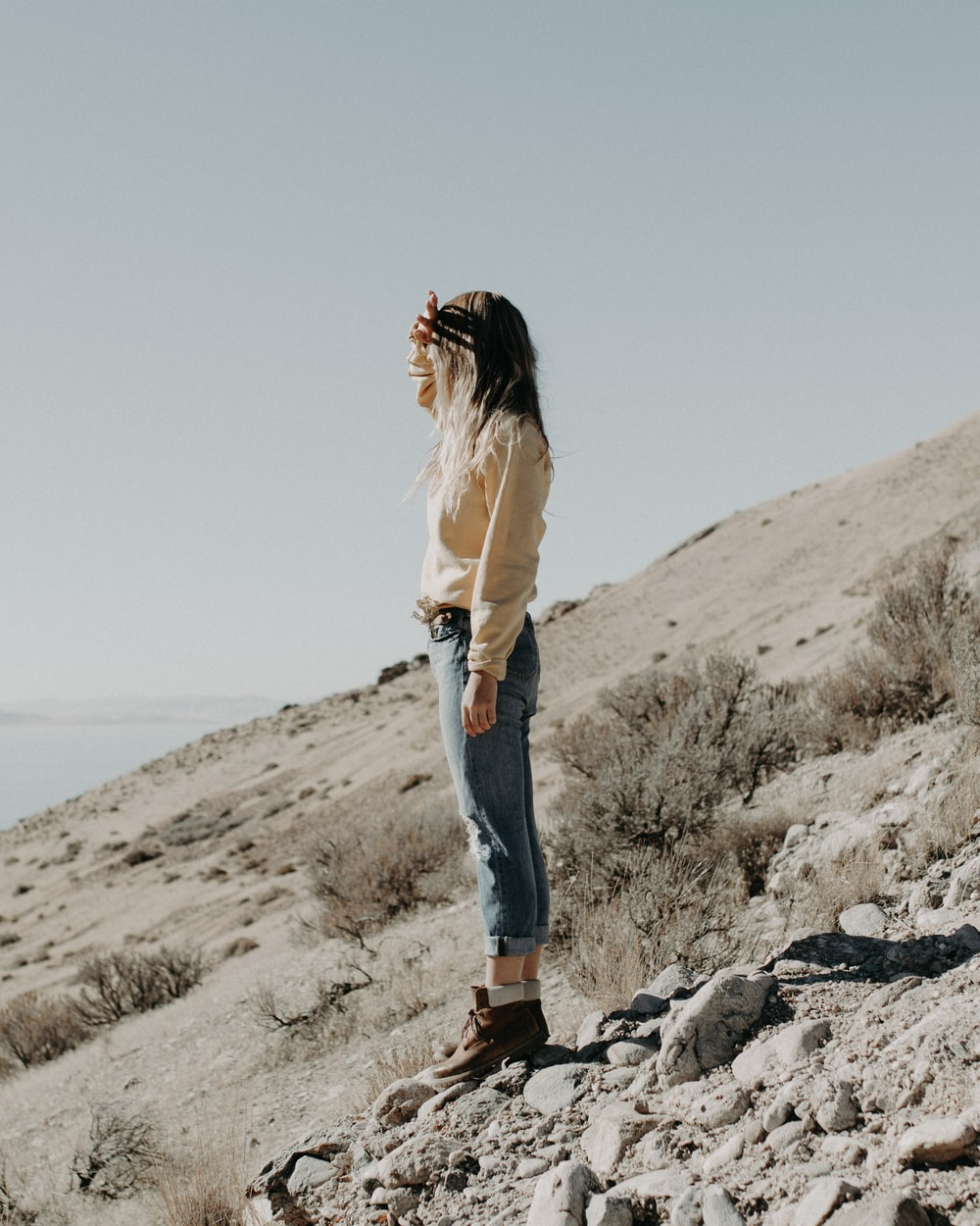 woman standing on hill