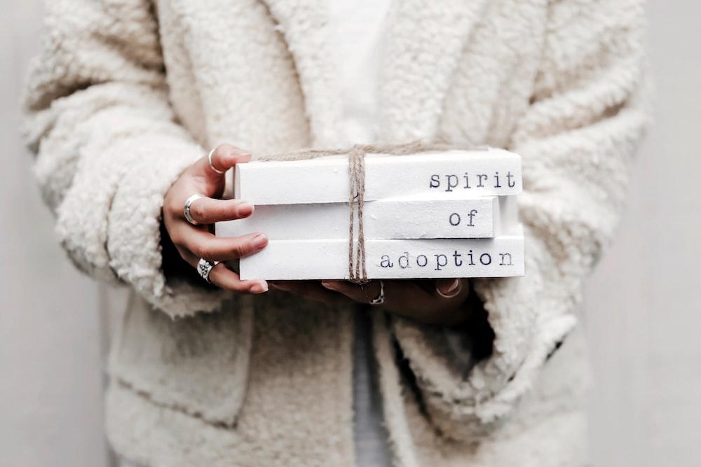 woman holding spirit of adoption blocks