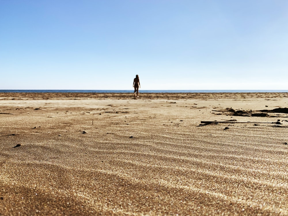 woman walking on sand