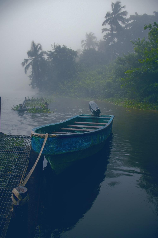 blue boat on lake