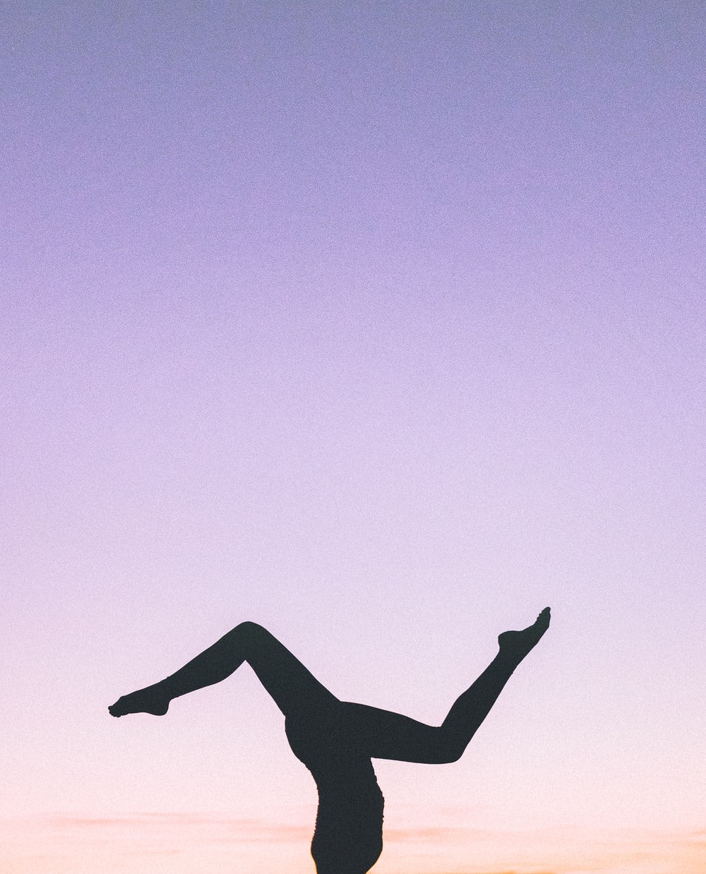 silhouette photography of person doing cartwheel