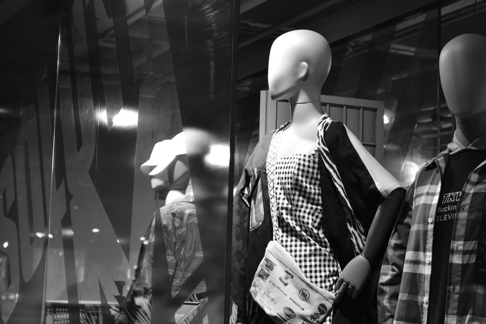 grayscale photo of mannequin with dresse s