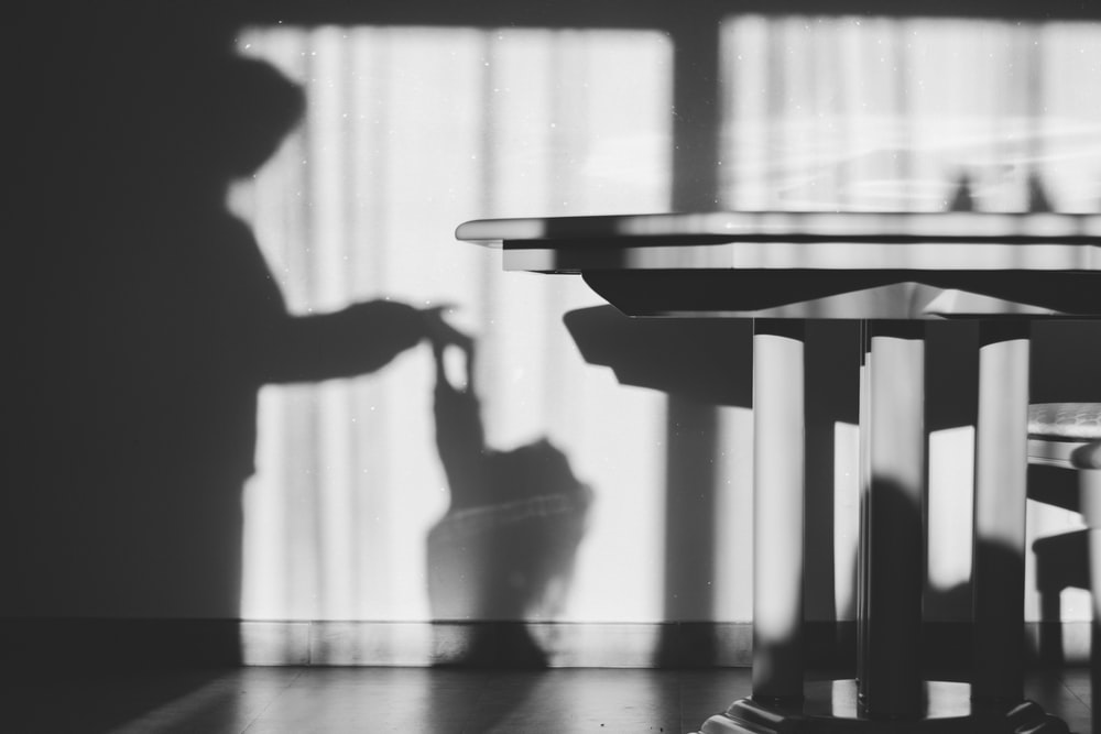 grayscale photography of table