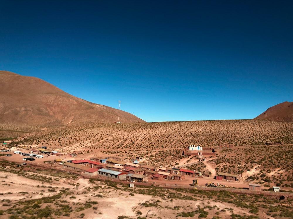 buildings on desert under blue sky