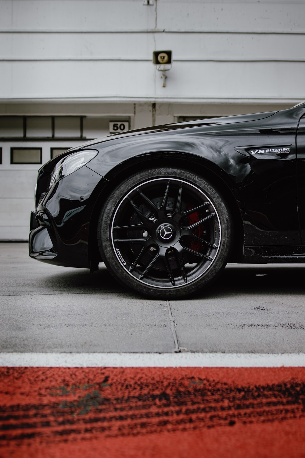 selective focus photography of parked black car during daytime