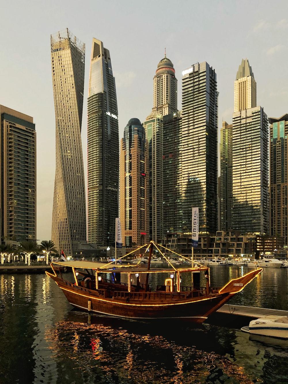 boat sailing near high-rise buildings