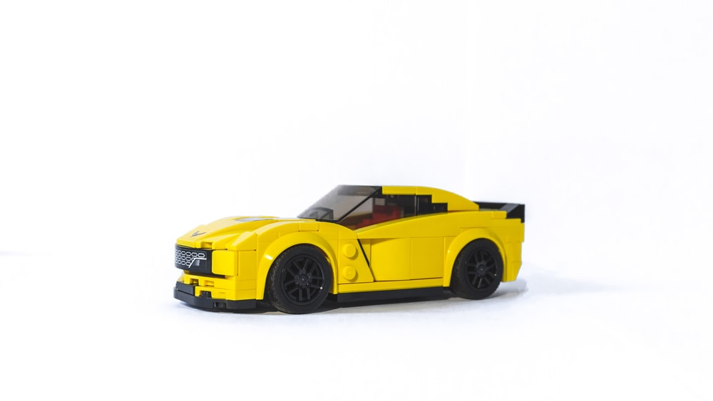 yellow coupe die-cast model