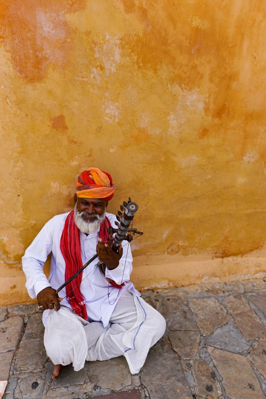 man playing instrument