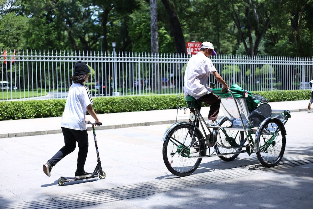 shallow focus photo of person riding bike during daytime