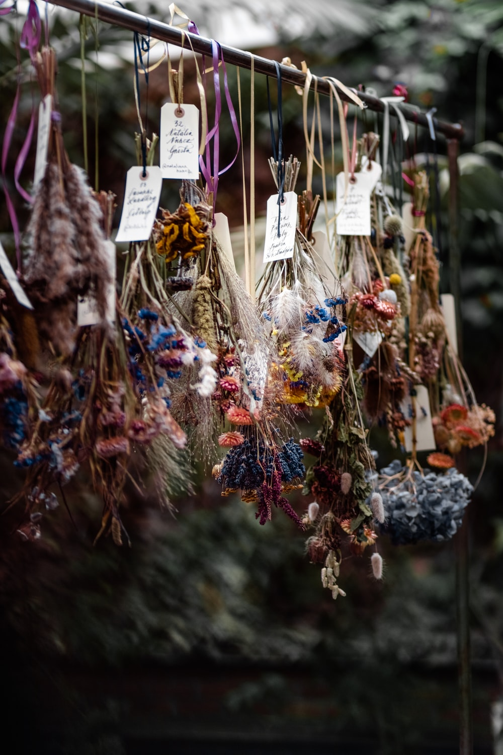 macro photography of assorted-color ornaments hanging on stick