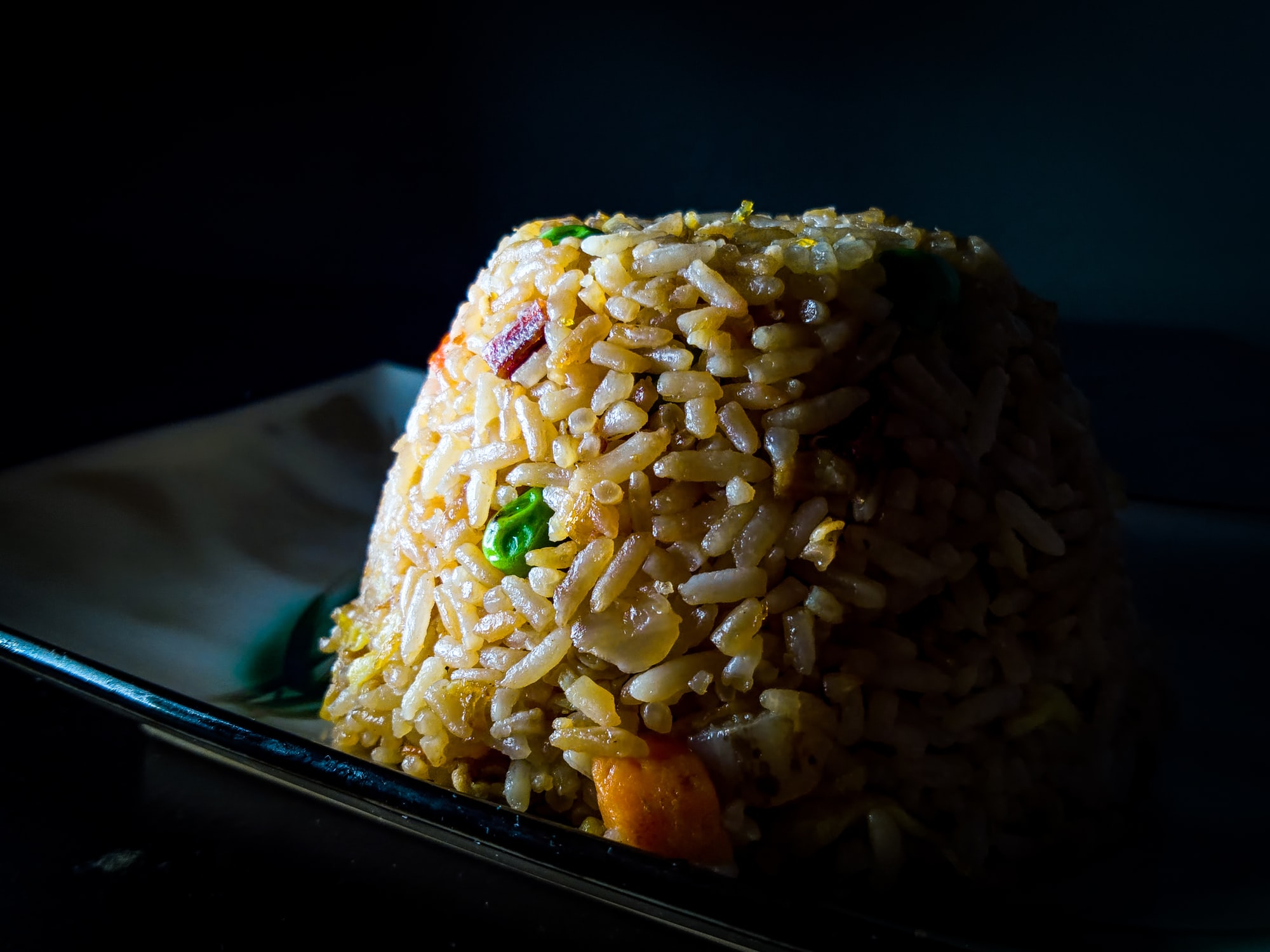 House Fried Rice on a small plate with Rembrandt lighting